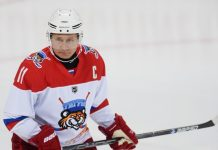 putin playing hockey russia